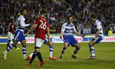 Yann Kermorgant celebrates scoring the first goal for Reading