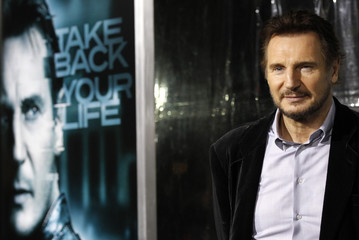 """Neeson poses at the premiere of """"Unknown"""" at the Mann Village theatre in Los Angeles"""