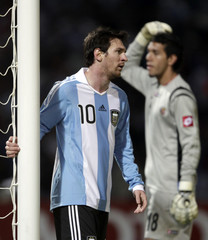 Argentina's Lionel Messi reacts next to Costa Rica's goalie Leonel Moreira  during their match in the first round of the Copa America soccer tournament, in Cordoba