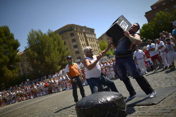 Basque stone lifter Inaxio Perurena raises a 270 kg granite block during an exhibition of traditional rural sports on the seventh day of the San Fermin festival in Pamplona