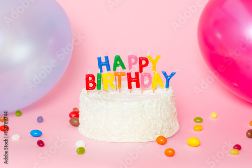 Happy Birthday Cake On Pink Background With Balloons