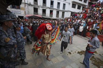 A masked dancer dances during Indrajatra festival in Kathmandu