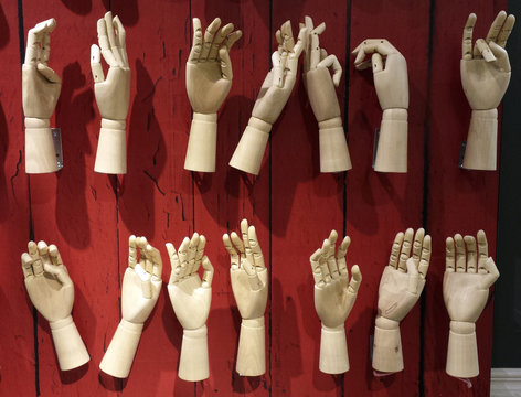 A sole pair of mittens adorned with Canada's maple leaf insignia is left on a display of mannequin hands at a department store in downtown Toronto