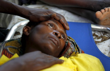 A sick Burundian refugee waits for treatment at a makeshift clinic on the shores of Lake Tanganyika in Kagunga village in Kigoma region in western Tanzania