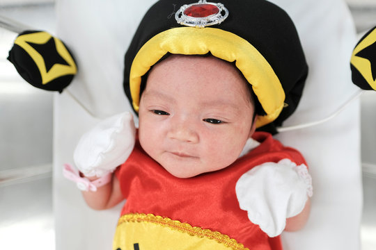 A newborn baby wearing a Chinese traditional costume to celebrate the Chinese New Year is pictured at the nursery room of Paolo Chockchai 4 Hospital, in Bangkok
