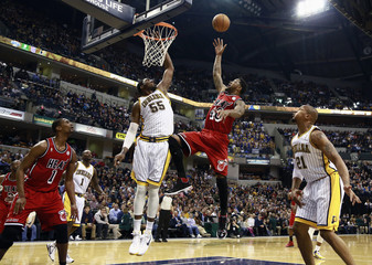Miami Heat's Haslem shoots while Indiana Pacers' Hibbert defends as Pacers' West  and Heat's Bosh watch during the first quarter of their NBA basketball game in Indianapolis, Indiana
