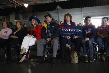 Audience members listen as Republican presidential candidate Rick Santorum speaks at a campaign event aboard the U.S.S. Yorktown at Patriot's Point in Mount Pleasant