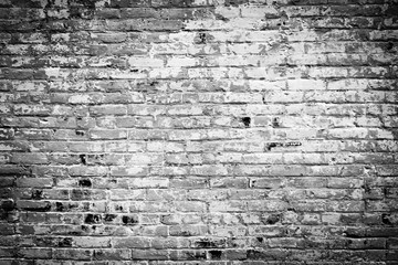 Old brick wall background. Black and white grunge texture.