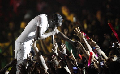 Hip hop artist Akon shakes hands with fans as he performs at the St Lucia Jazz and Arts Festival at Pigeon Island National Landmark