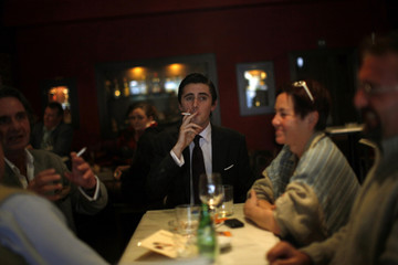 A man smokes a cigarette in the Asador de Guadalmina restaurant in Marbella