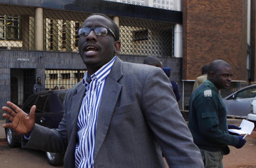 Editor of the state-run Sunday Mail newspaper Edmund Kudzayi walks out of the Harare Magistrates Court after he was granted bail