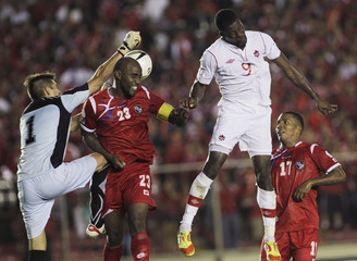 Panama's goalkeeper Penedo makes a save as Canada's Ricketts tries to score next to Panama's Baloy and Henriquez during their 2014 World Cup qualifying soccer match in Panama City
