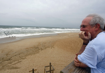 Local resident John Parker looks out over the Atlantic Ocean as the area awaits Hurricane Earl in Nags Head