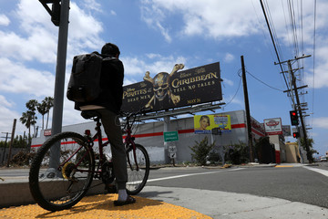 "A billboard advertising the Walt Disney Company's new movie ""Pirates of the Caribbean"" - Dead Men Tell No Tales\"