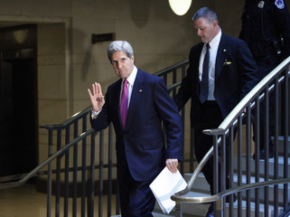 U.S. Secretary of State Kerry acknowledges reporters as he arrives to attend a House Select Intelligence Committee closed briefing on the situation in Syria, in Washington
