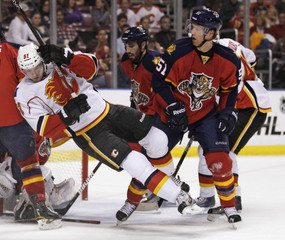 Calgary Flames Roman Horak is checked by Florida Panthers Brian Campbell during first period of NHL hockey game in Sunrise