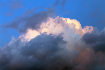 blue sky over a rain cloud with white top