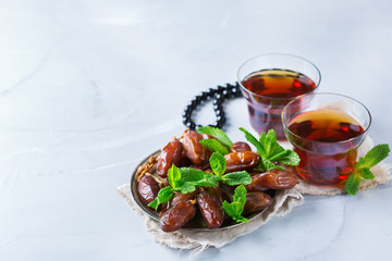 Ramadan ramazan kareem. Traditional arabic tea with mint and dates