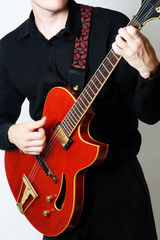 Electric guitar player. Guitarist playing red guitar