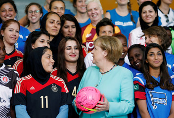 """German Chancellor Merkel and international female soccer players of the """"Discover Football"""" project pose for a group picture at the chancellery in Berlin"""