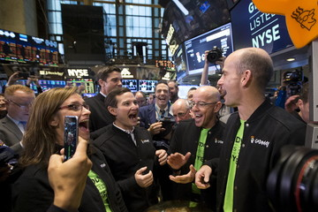 Excutives, traders and guests celebrate during the IPO ceremony for web hosting company GoDaddy on the floor of the New York Stock