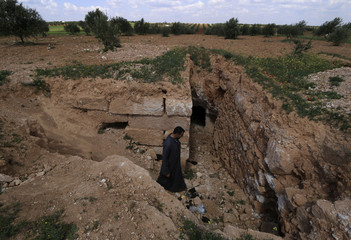 A man enters underground shelter in Idlib countryside