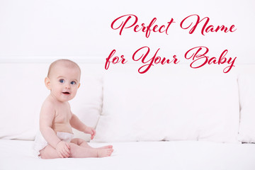 Cute funny baby sitting on bed at home