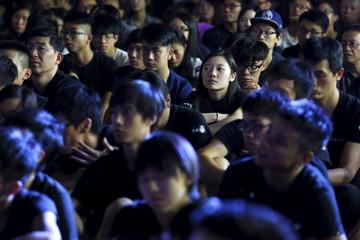 University students wearing black attend a rally at the University of Hong Kong in Hong Kong