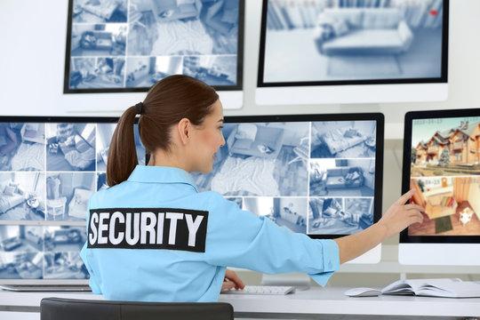 Beautiful security guard in surveillance room