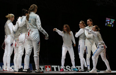 Members of Italy's women's foil team dance before their final match against Russia at the World Fencing Championships in Kazan