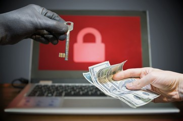 Fototapeta Computer security and extortion concept. Ransomware virus has encrypted data in laptop. Hacker is offering key to unlock encrypted data for money.