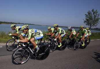 Tinkoff-Saxo rider Alberto Contador of Spain cycles with team-mates during a training session in Utrecht