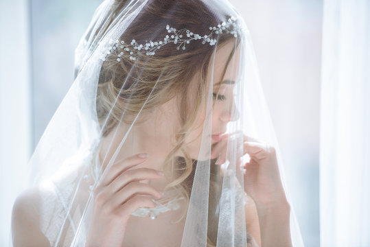 Closeup brunette bride with fashion wedding hairstyle and makeup