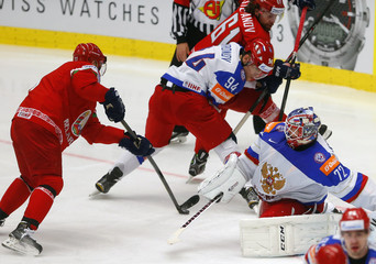 Kulakov of Belarus challenges Russia's goaltender Bobrovski during their Ice Hockey World Championship game at the CEZ arena in Ostrava