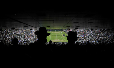 Spectators on Centre Court watch the men's quarter-final tennis match between Andy Murray of Britain and Fernando Verdasco of Spain at the Wimbledon Tennis Championships, in London