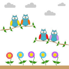 Owls on a branch of a tree
