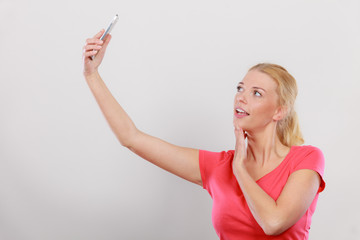Woman taking picture of herself with phone