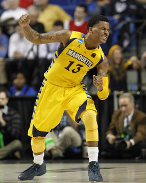 Marquette University's Vander Blue reacts after making his shot and drawing the foul against Butler University during the second the half of their third round NCAA basketball game at Rupp Arena in Lexington
