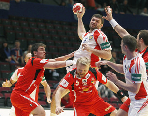 Russia's Rastvortsev attempts to score next to Iceland's Atlason and Ingimundarson during their Men's European Handball Championship second round match in Vienna