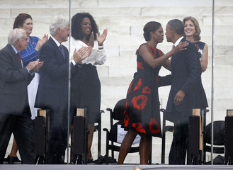 Michelle Obama kisses Barack Obama during March on Washington ceremony in Washington