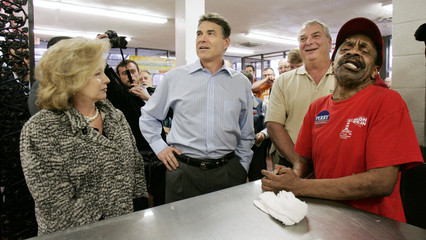 U.S. Republican presidential candidate Perry and his wife give their orders during a campaign stop in Spartanburg