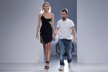 Fashion designer Anthony Vaccarello appears at the end of his Spring/Summer 2014 women's ready-to-wear fashion show during Paris fashion week