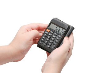 Calculator with numbers on display in the hands