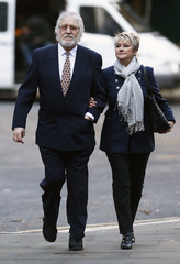 Former Radio 1 DJ Dave Lee Travis arrives with his wife Marian Griffin at Southwark Crown Court in London