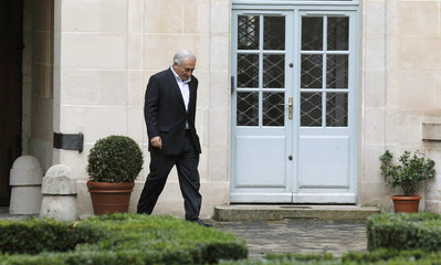 Former IMF chief Strauss-Kahn walks in the courtyard of his residence in Paris