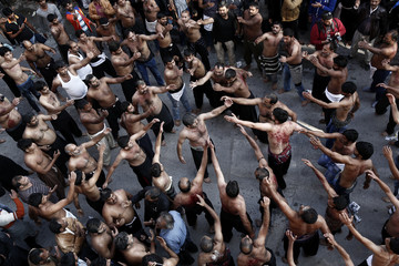 Shi'ite Muslims take part in a Muharram procession marking Ashoura in Piraeus port town, near Athens