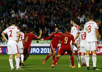 Spain's Isco celebrates after scoring against Belarus during their Euro 2016 Group C qualifying soccer match in Huelva