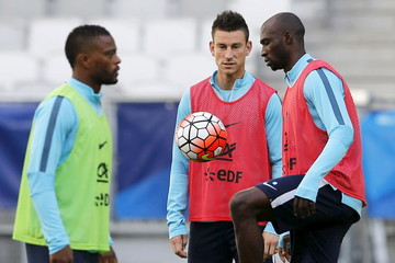France's Patrice Evra, Laurent Koscielny and Eliaquim Mangala attend training session in Bordeaux
