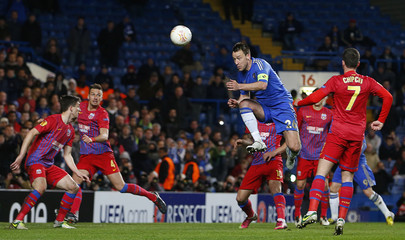 John Terry of Chelsea heads to score against Steaua Bucharest during their Europa League match at Stamford Bridge in London