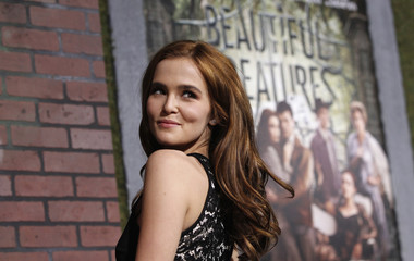 """Cast member Deutch poses at premiere of """"Beautiful Creatures"""" in Hollywood"""